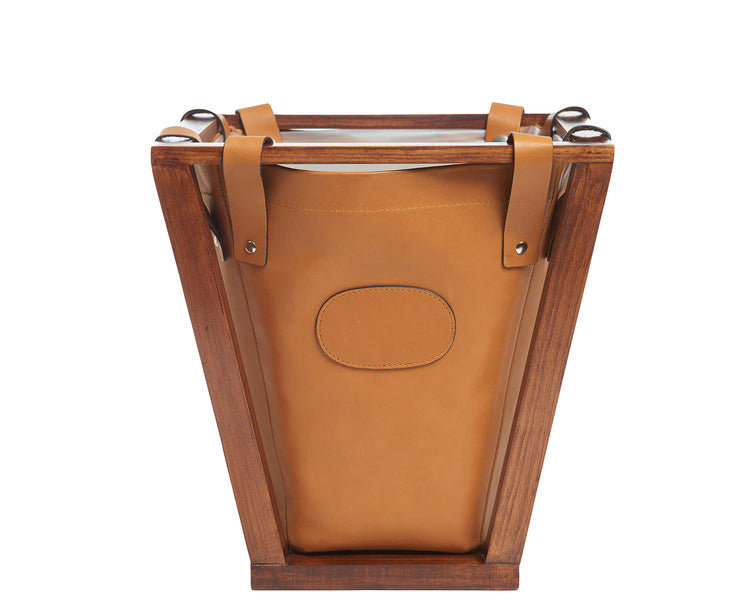 "Tan Full-grain American leather Strong pine wood frame construction Removable, easy to clean liner 4-gallon capacity Each waste basket's selection is one-of-a-kind and slightly unique given the natural characteristics of the leather Handcrafted with care in our own factory Dimensions: 12"" W x 12.25"" H (base measures 7.5"" W)"