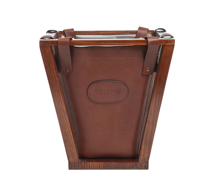 Chocolate Leather wastebasket Here's a wastebasket you won't want to hide in the corner or under a desk. The Winslow leather wastebasket features full-grain American leather that is suspended securely on a beautiful pine wood frame. The Winslow leather wastebasket has a 4-gallon capacity and is the perfect size for your home office, bedroom or bathroom