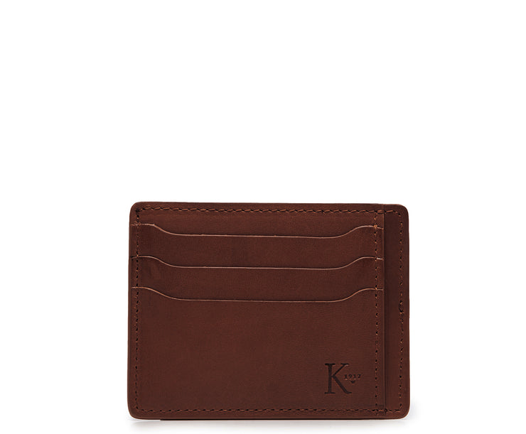 Brown Slim leather wallet Handcrafted with full-grain vegetable tanned leather, this slim wallet is designed with simplicity and functionality in mind. Made to slip easily into back pockets, the Knox has six scalloped credit card slots and two vertical stash pockets.