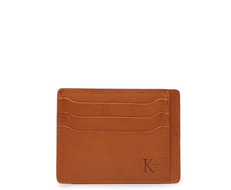 Tan Slim leather wallet Handcrafted with full-grain vegetable tanned leather, this slim wallet is designed with simplicity and functionality in mind. Made to slip easily into back pockets, the Knox has six scalloped credit card slots and two vertical stash pockets.