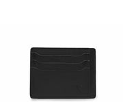 Black Slim leather wallet Handcrafted with full-grain vegetable tanned leather, this slim wallet is designed with simplicity and functionality in mind. Made to slip easily into back pockets, the Knox has six scalloped credit card slots and two vertical stash pockets.