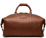 "Brown 22"" Leather Weekender  The Twain weekender in Korchmar's Classic Leather is made of American cowhide leather that is selected from the top 5% of available hides. Colored only with aniline dyes, this leather retains its natural beauty over time and features visible markings that are characteristic of only the finest leather. One of our best-selling weekender styles, the Twain is ideal for leisure or business travel."