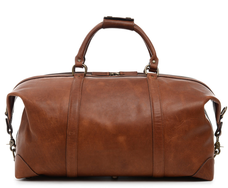 "Espresso One of our best-selling weekender styles, the Twain is ideal for leisure or business travel. At 22"", it is designed to fit comfortably in most airline overhead compartments. The Twain leather duffel bag is handcrafted in the USA with full grain leather that develops a beautiful patina with time. It includes a removable, adjustable shoulder strap."