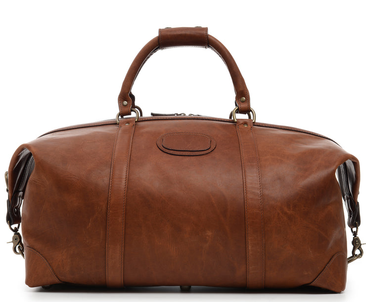 "Espresso 22"" Leather Weekender  One of our best-selling weekender styles, the Twain is ideal for leisure or business travel. At 22"", it is designed to fit comfortably in most airline overhead compartments. The Twain leather duffel bag is handcrafted in the USA with full grain leather that develops a beautiful patina with time. It includes a removable, adjustable shoulder strap."