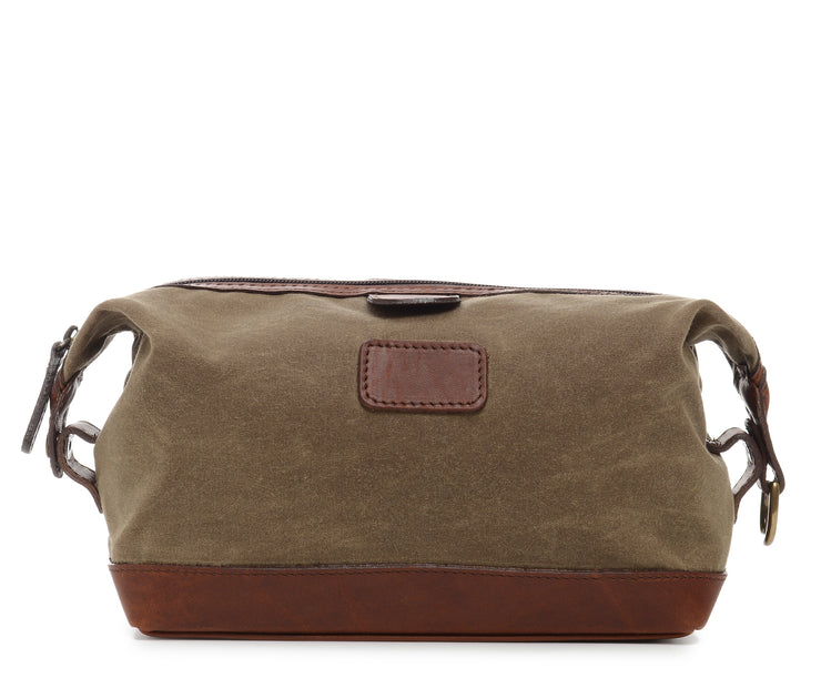 Olive Waxed Canvas Dopp Kit The Ryder is a compact waxed canvas toiletry bag with full grain leather trim. This Dopp Kit features a top zipper and snap down ends that allow for maximum expansion.