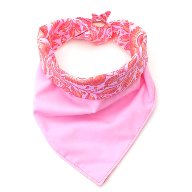 Bright Eyes reversible dog bandana showing pink side