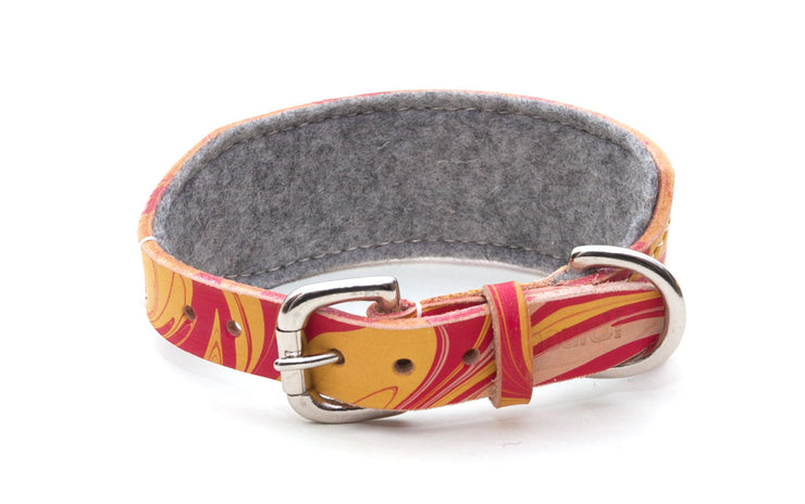 Leather hound collar, patterned red and yellow, showing buckle and grey felt lining