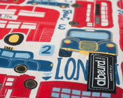 close up of fabric showing London cabs and red buses