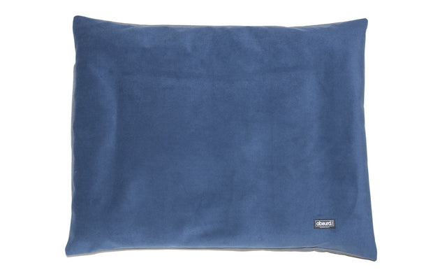 reversible cushion dog bed showing dusty blue velvet side