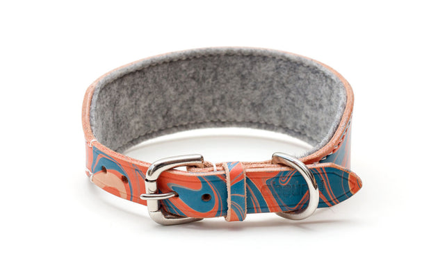 Leather hound collar, patterned red and blue, showing buckle and felt lining