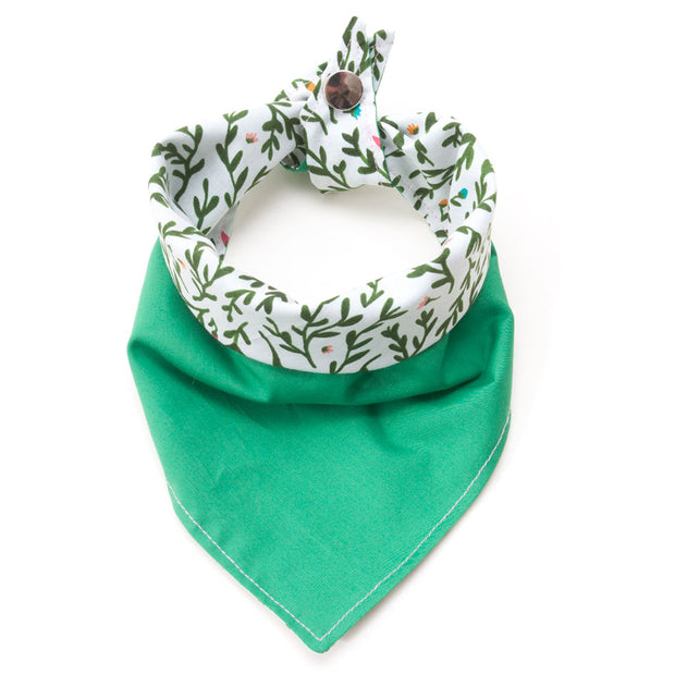 Flora reversible dog bandana showing green side