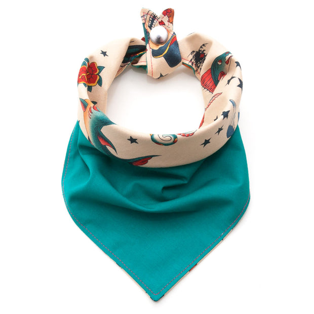 Inked dog bandana showing green side