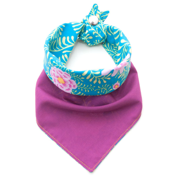 Reversible dog bandana showing fuchsia pink side