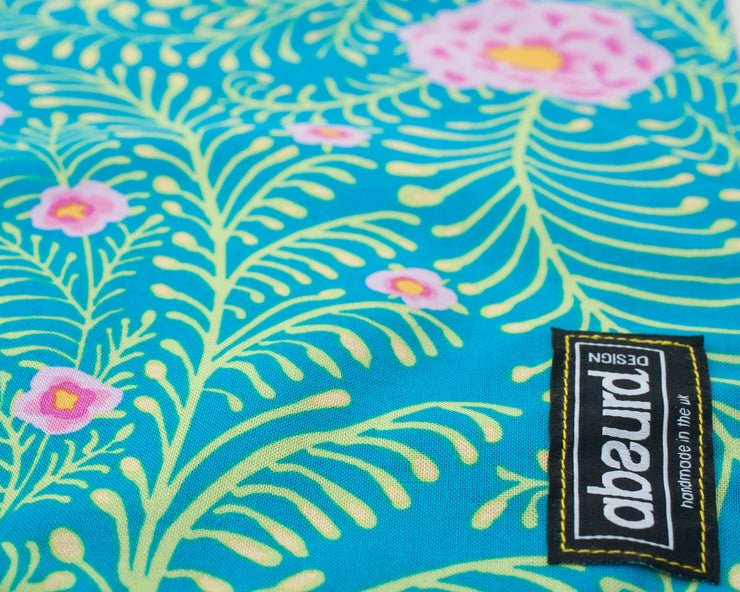 close up of Paradise pretty cotton floral patterned fabric
