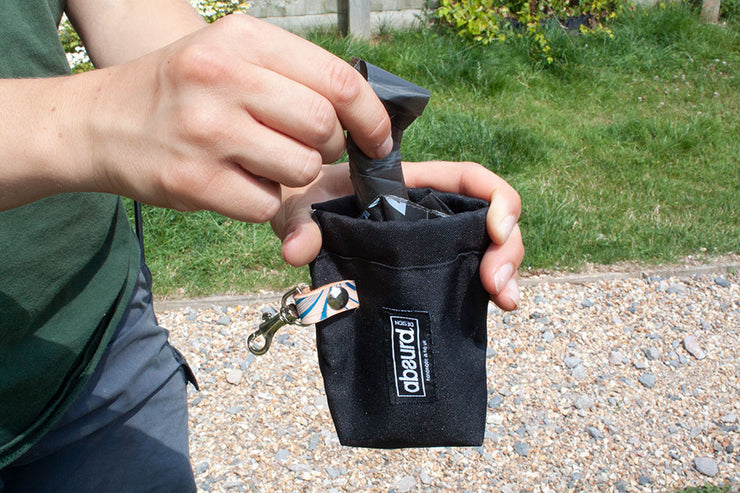 easy open squeeze action on dog poop bag holder