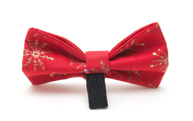 Fabric dog bow tie showing elastic loop for attaching to collar