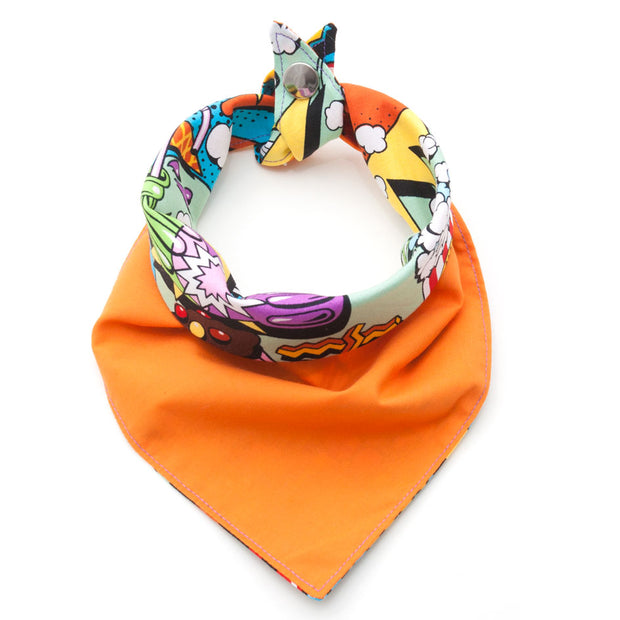 Sweet Tooth reversible dog bandana showing orange side