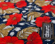 close up of fabric, red flowers and gold leaves on navy