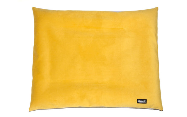 reversible cushion dog bed showing yellow velvet side