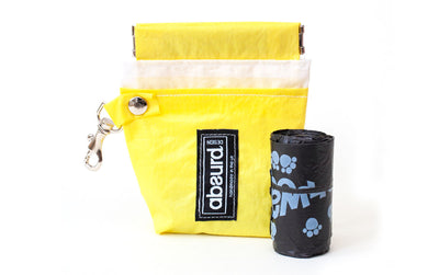 yellow dog treat pouch and dog poop bag dispenser
