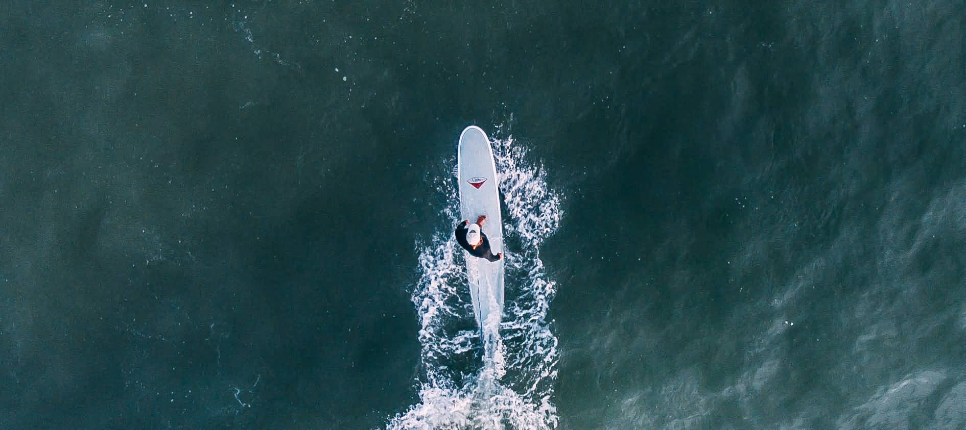 Aerial View Of Man Surfing