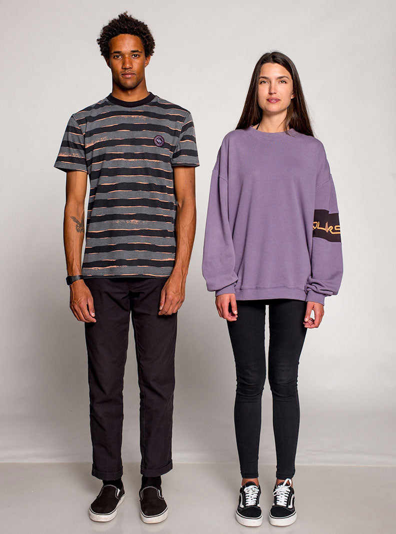 Man wearing a grey tshirt with black stripes and a girl wearing a purple sweater