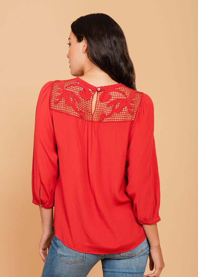 Bright red top with lacework neckline Brick