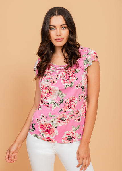 Pink pastel top with red and white floral detail Pink
