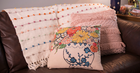Quinn's throw, floral pillow and light pink fringe pillow