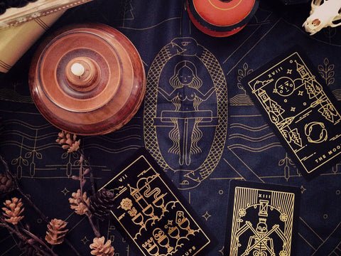 At the center of the golden thread tarot cloth lies the universe