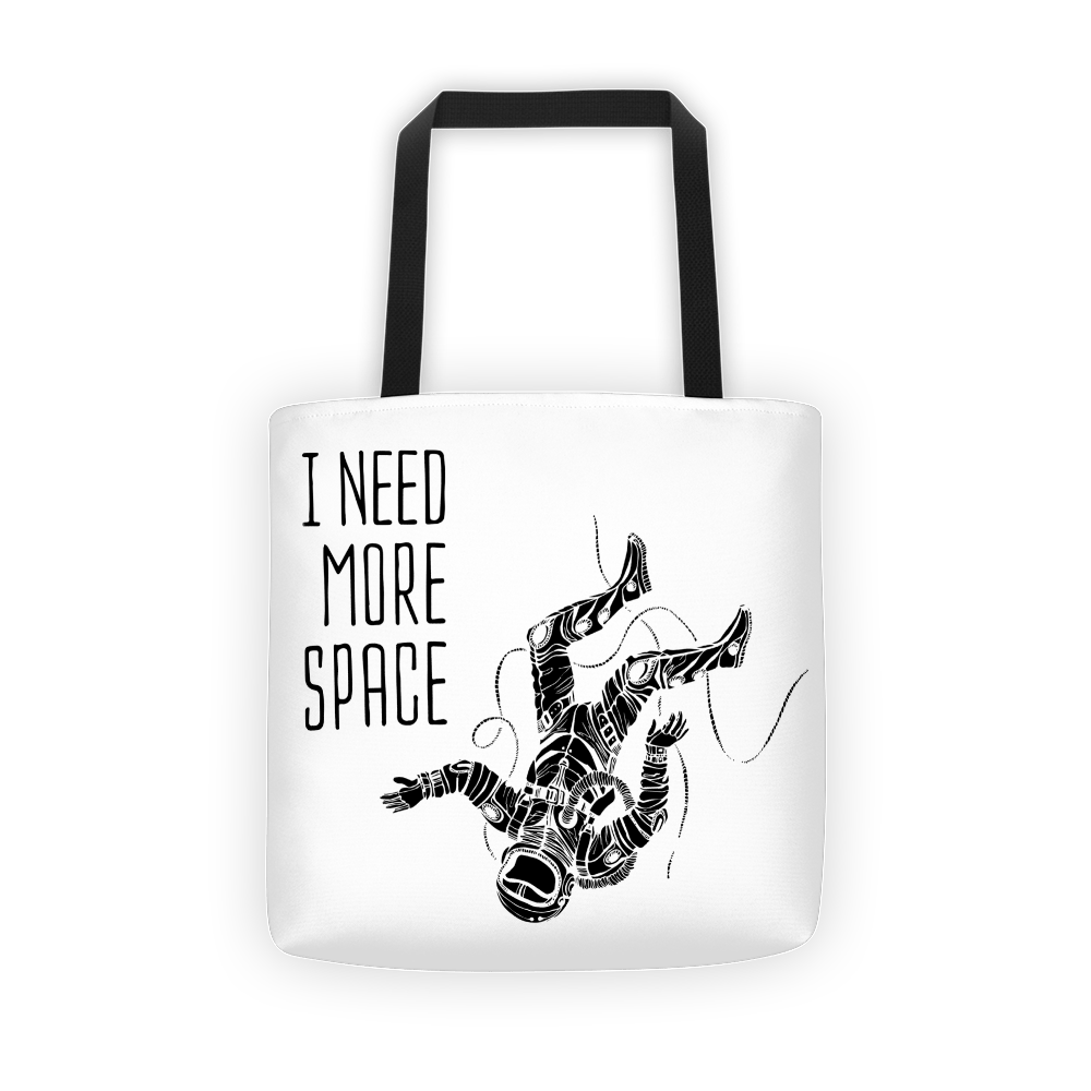 Floating spaceman Tote bag