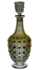 Antique cut glass decanter with blue diamonds