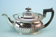 Partially polished silver teapot