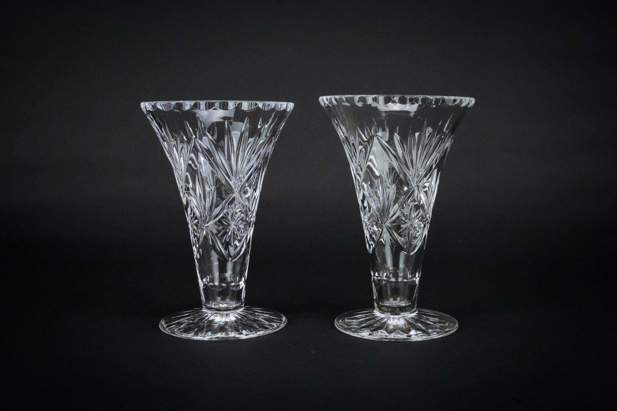 2 cut glass fluted vases