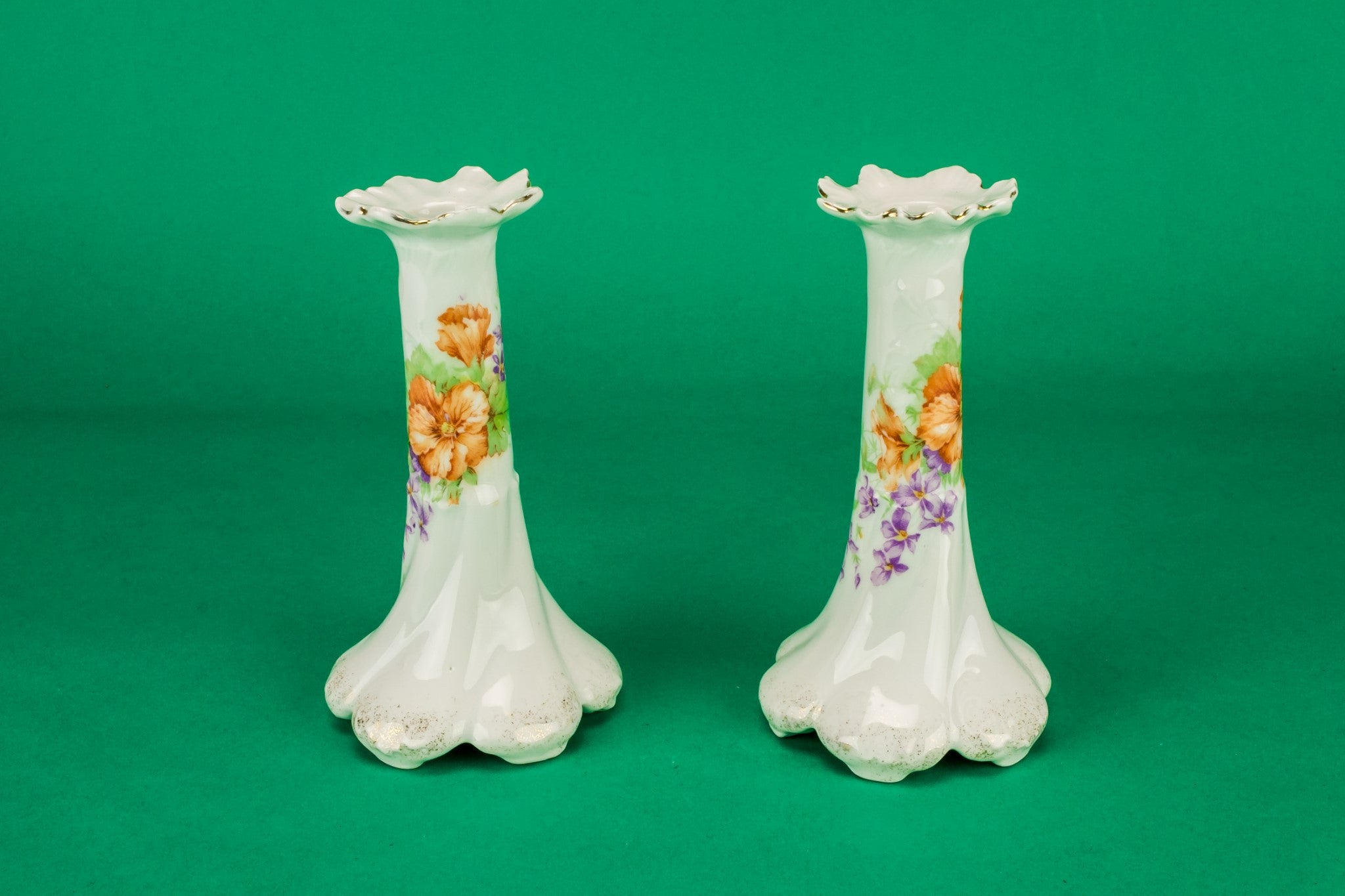 2 white floral candlesticks