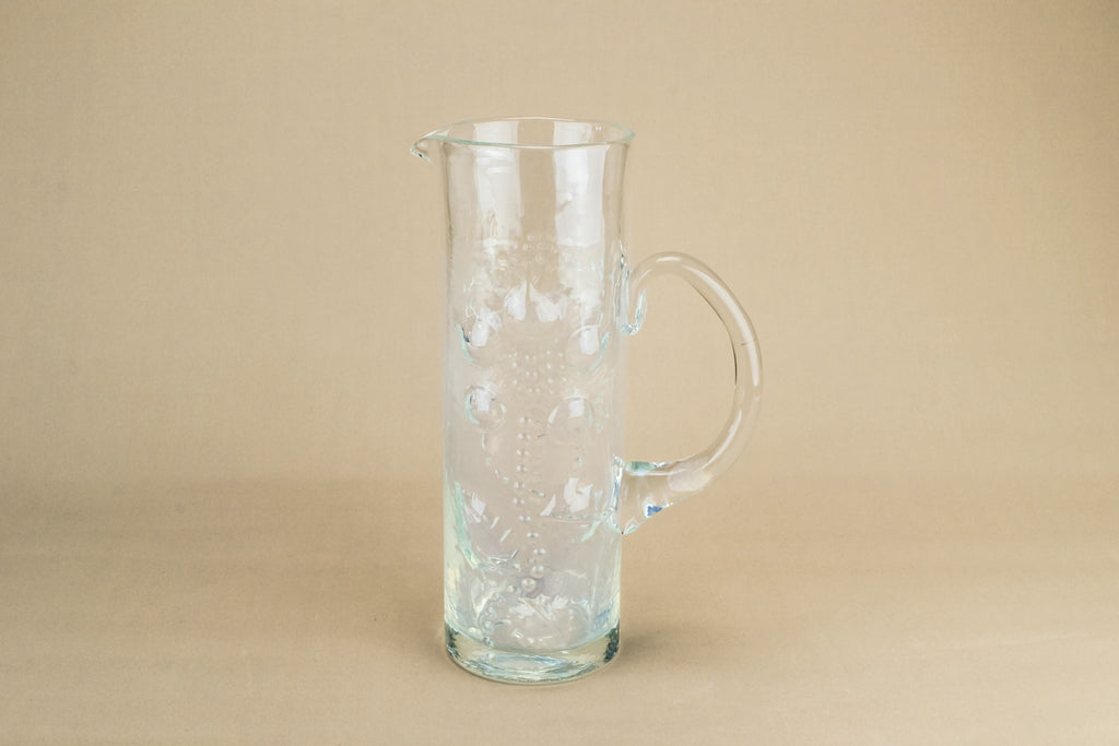 Tall glass water jug