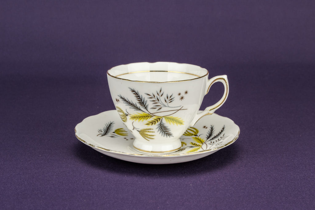 2 yellow teacups and saucers
