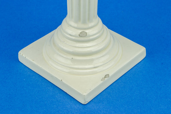 Tall cream candlestick