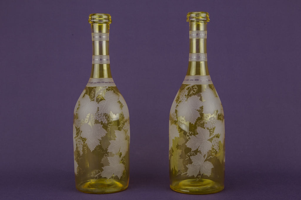 2 yellow glass wine bottles