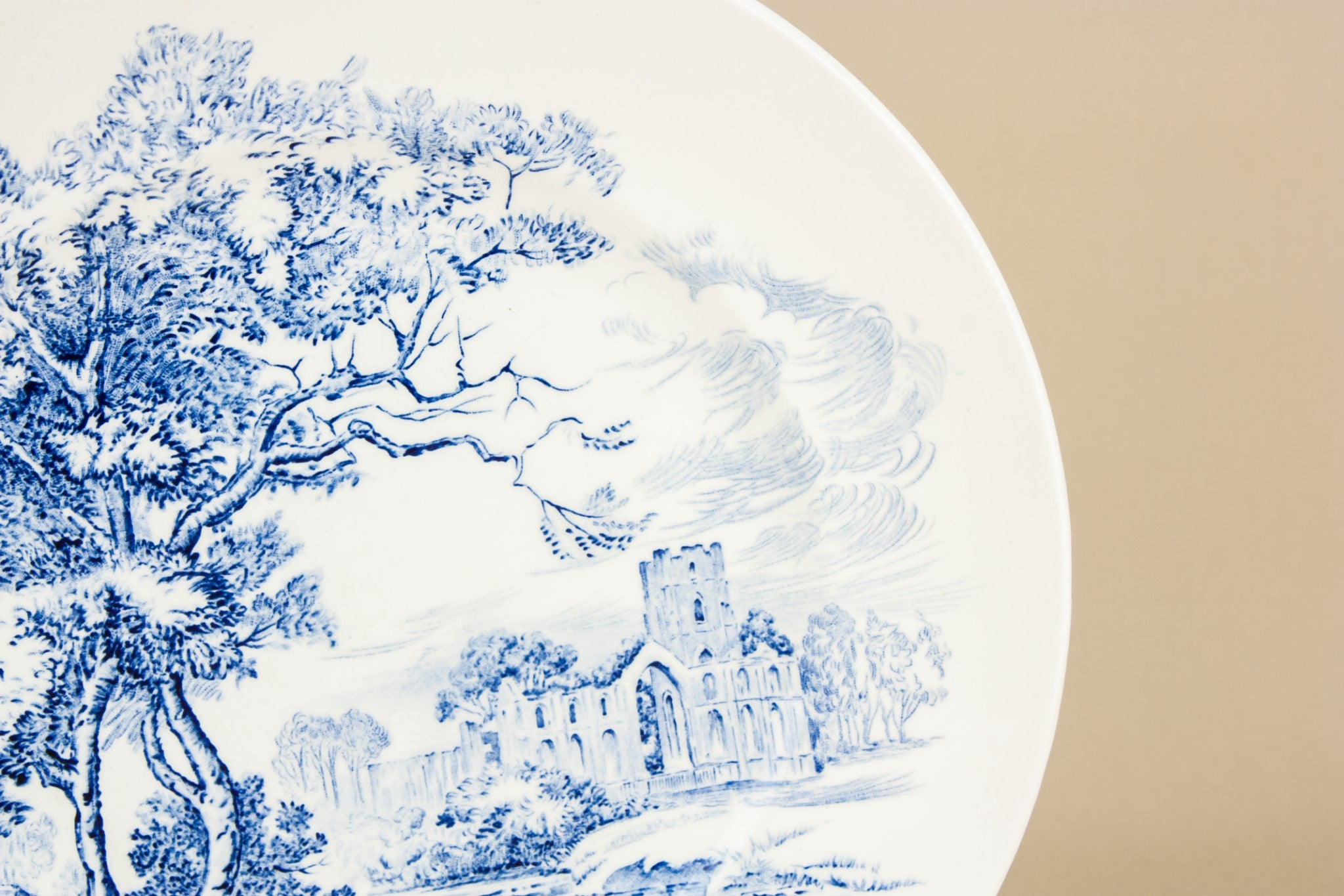 4 blue and white medium plates