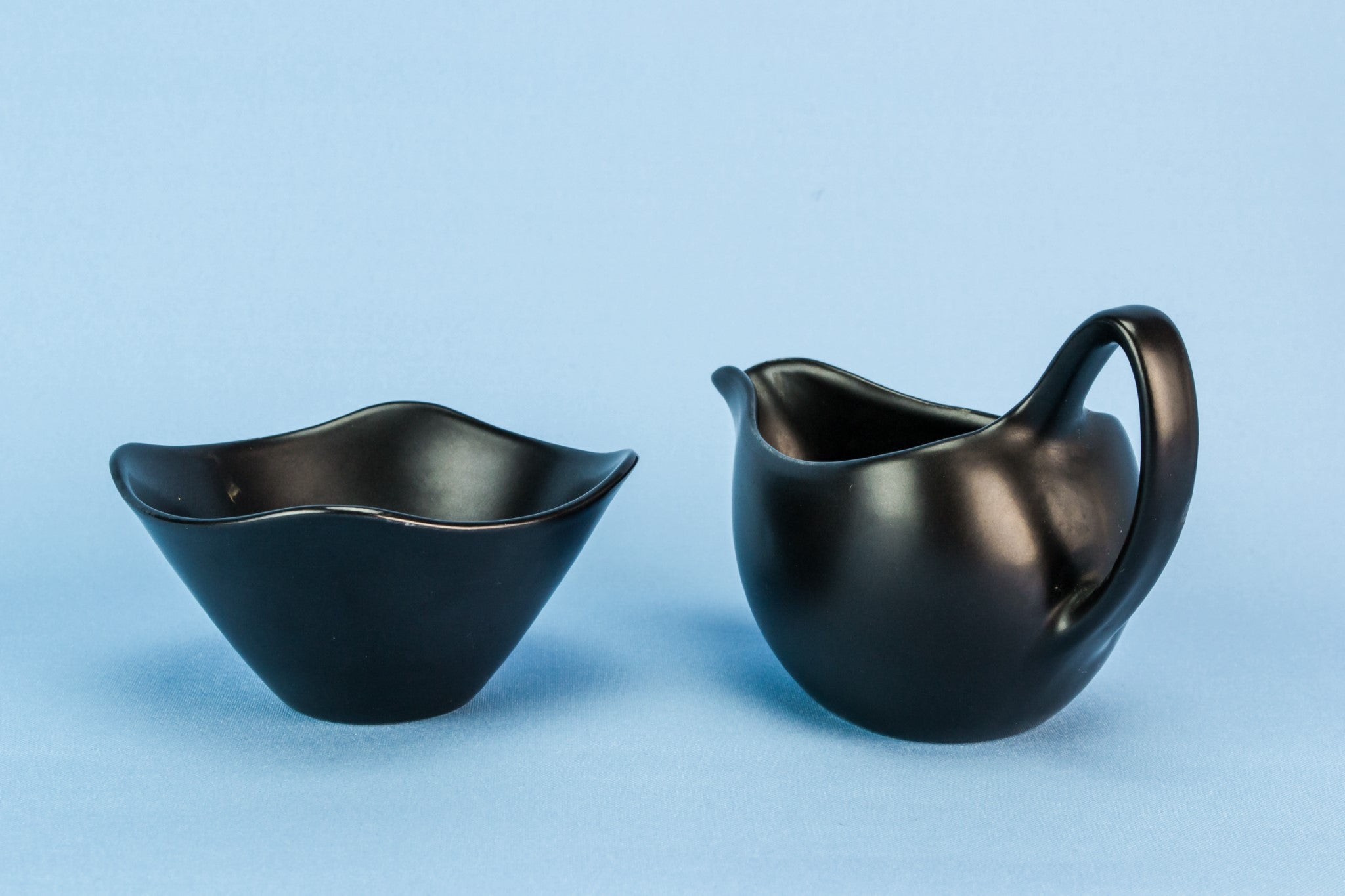 Black creamer and sugar bowl