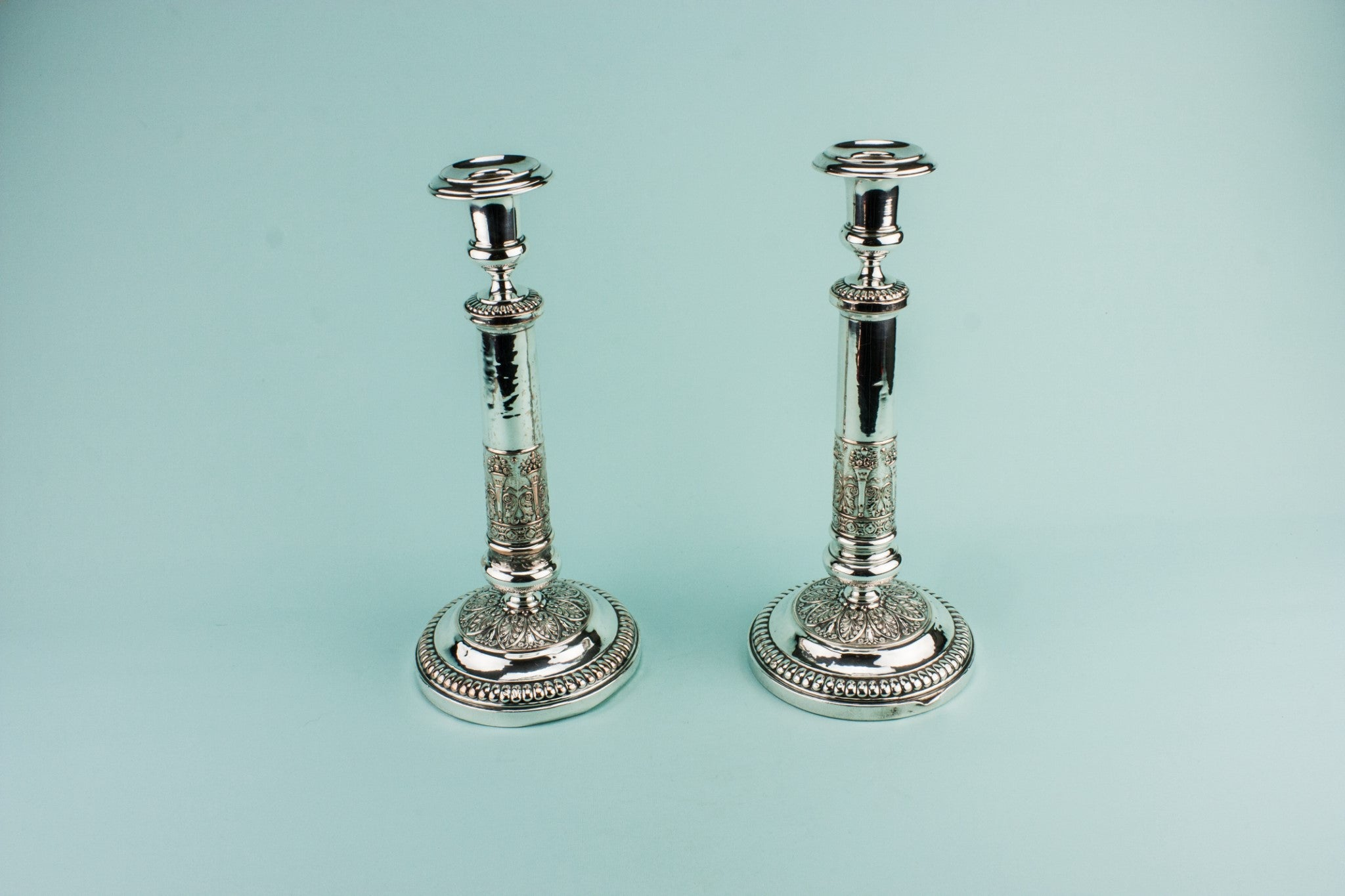 2 tall candlesticks