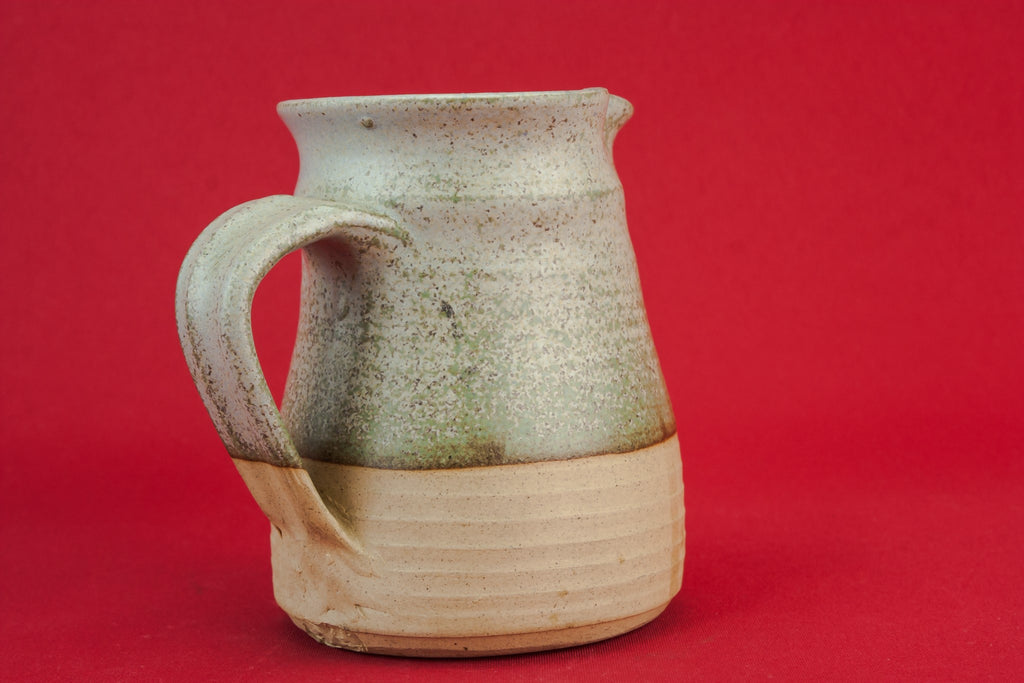 Grey pottery creamer