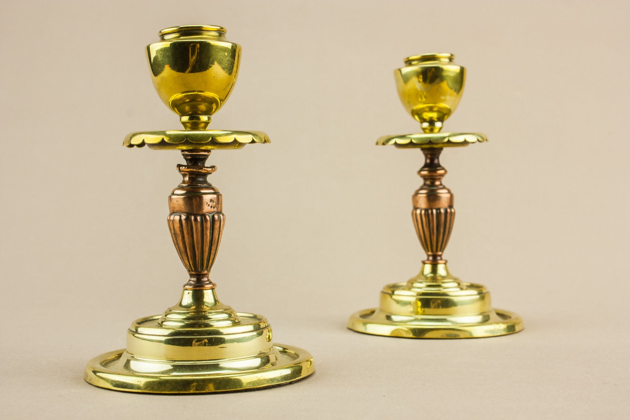 2 small brass candlesticks