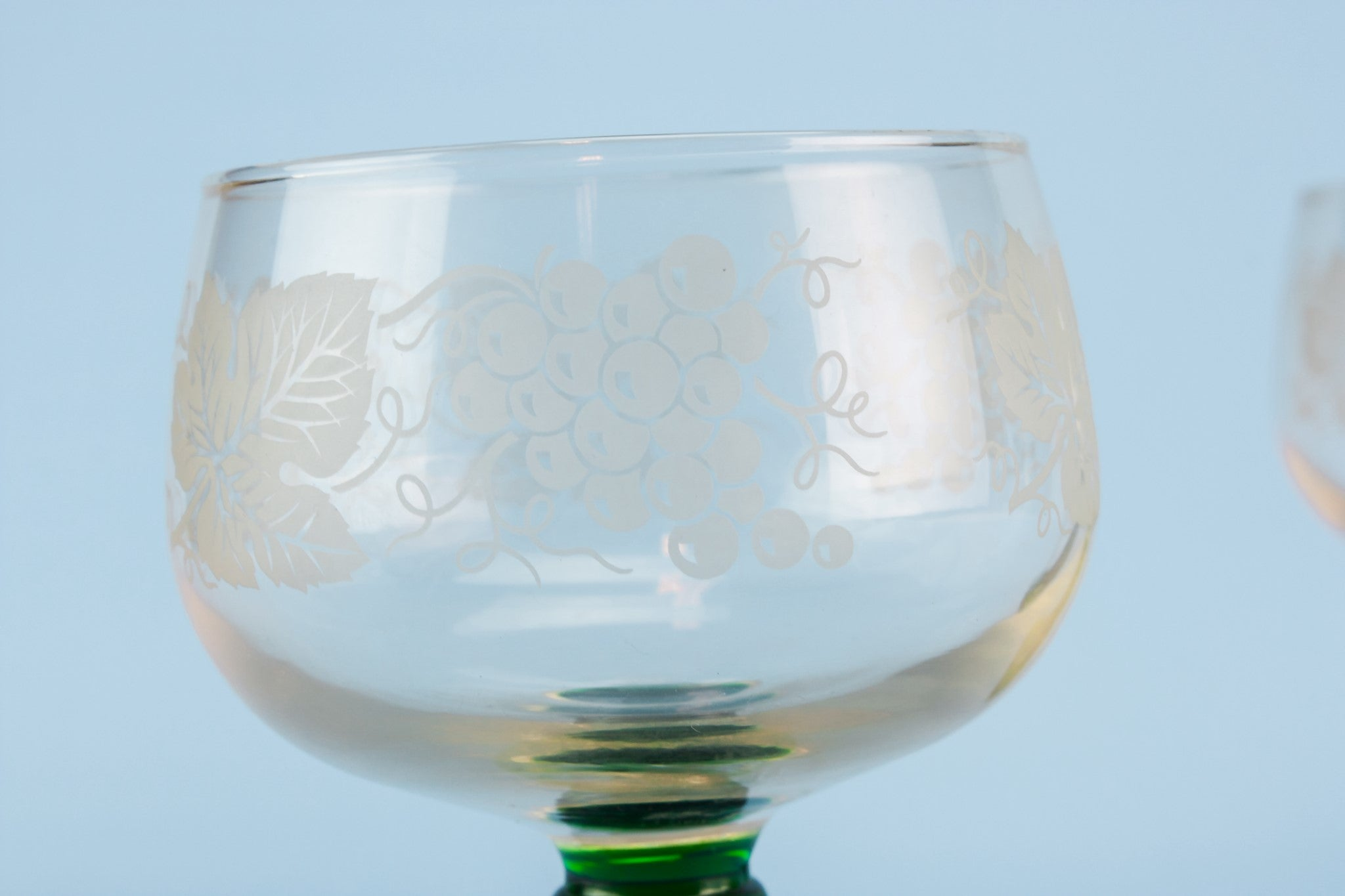 2 green wine glasses