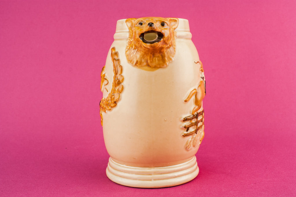Orange pottery creamer