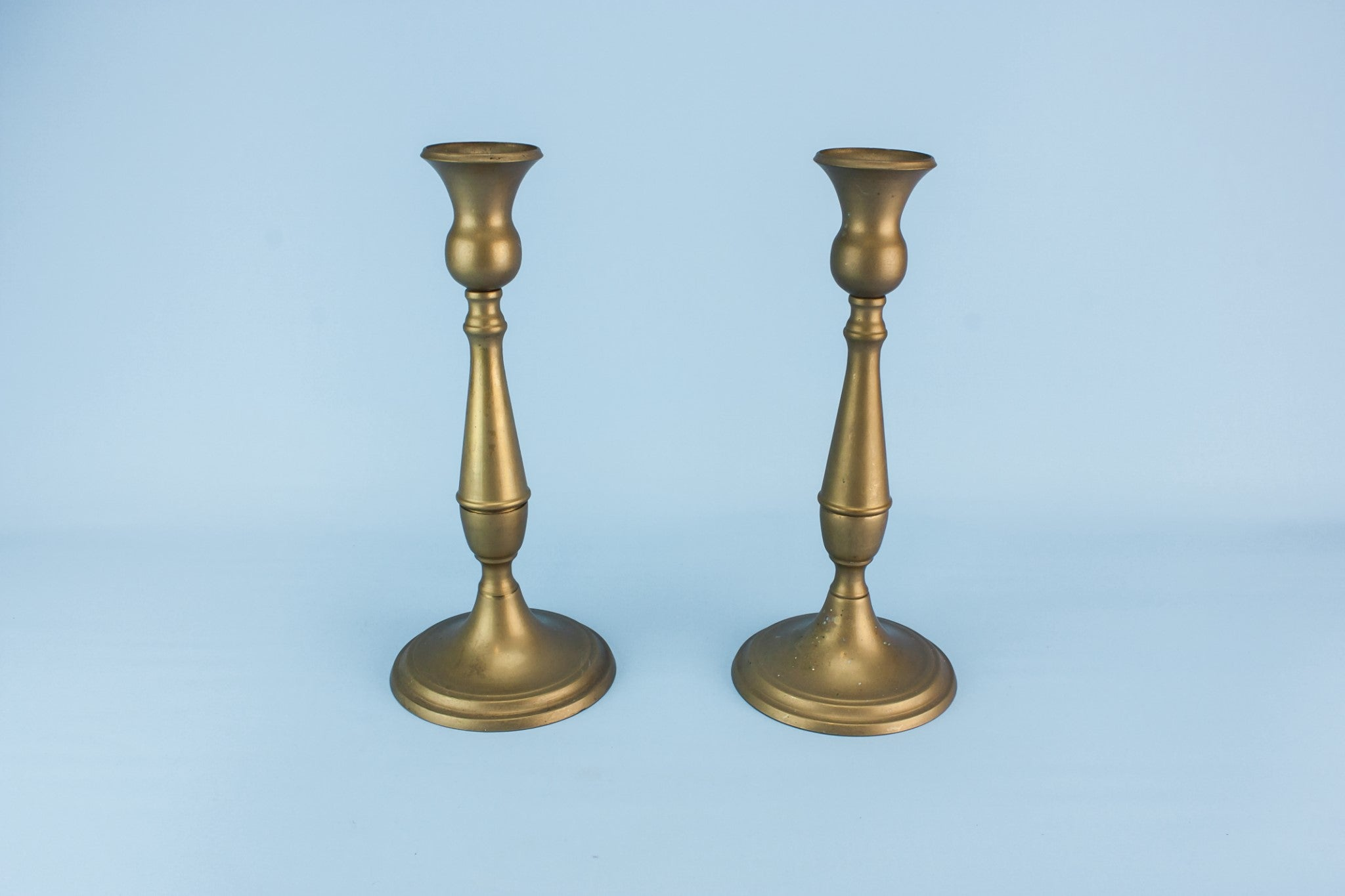 2 brass tall candlesticks