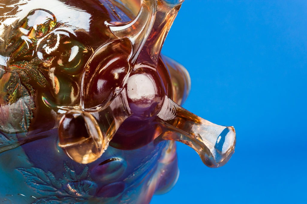 Carnival glass tripod bowl