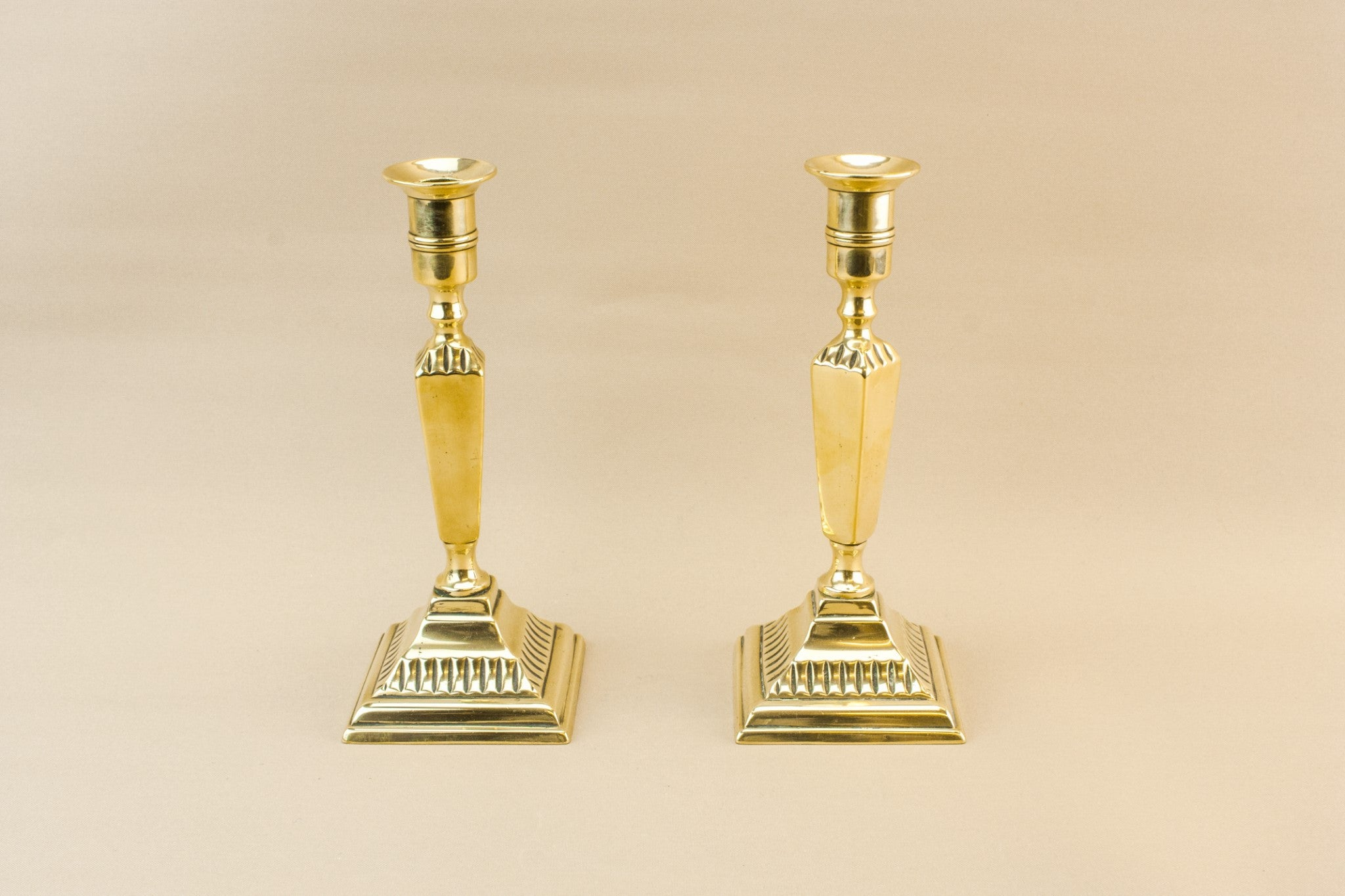 2 brass candlesticks