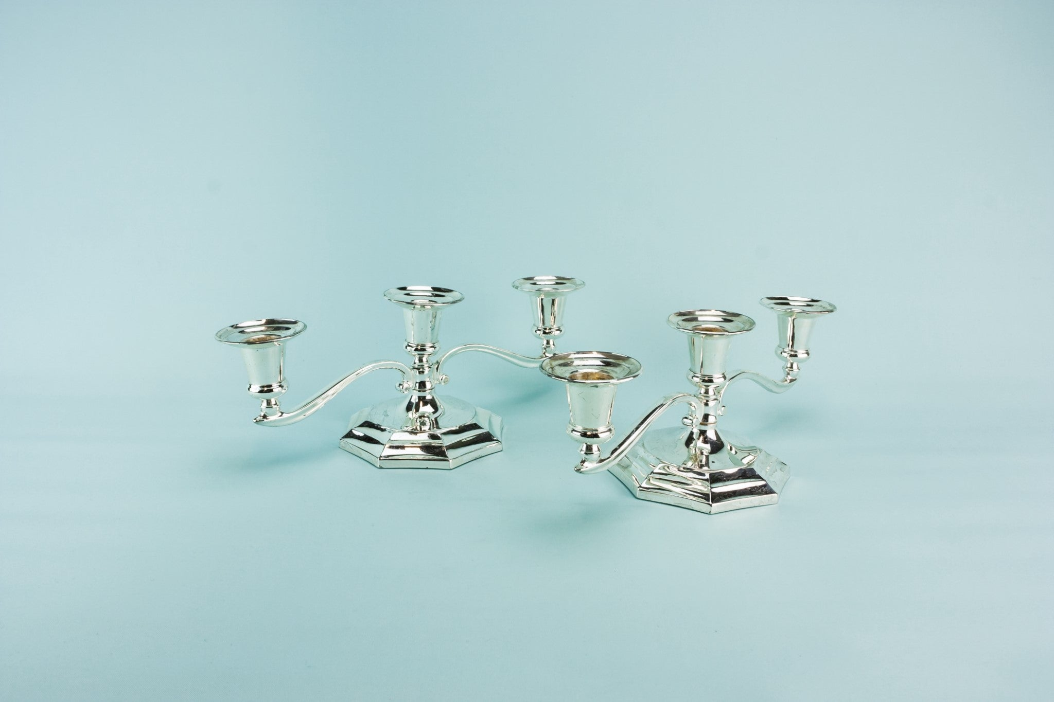 2 metal small candelabras